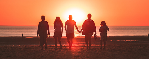 A family enjoying a vacation in the US, thanks to the family-based Green Card Visa